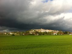 A storm approached from the the west side of Monflanquin as the sun starts to go down.