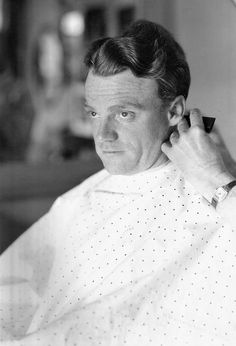 James Cagney photographed by Irving Lippman getting a haircut, c. 1930s