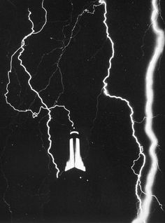 The Empire State Building during a lightning storm in the summer of 1934. Photograph by John P. Gaty.
