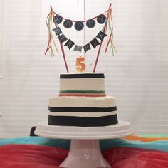 Simple 2 tiered cake for a rainbow birthday party. White cake. Raspberry filling. Orange frosting. Yum!