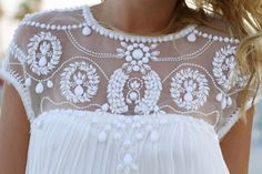 white bead and embroidered detailing with chiffon and pleats