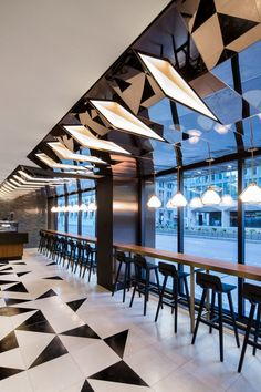 Sid Lee Architecture has completed an extensive renovation for one of Montreal's most prestigious hotels, opening its lobby and public spaces to serve a broader clientele than just hotel guests.