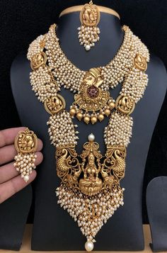 Buy online Golden Goddess Pendant Necklace Set With Earrings Online. International & Domestic shipping available.Shop more Handloom Pendant Necklace Set With Earrings at Luxurionworld. Fancy Jewellery, Gold Jewellery Design, Stylish Jewelry, Gold Jewelry, Jewelery, Pearl Necklace Designs, Jewelry Design Earrings, Necklace Set, Pendant Necklace