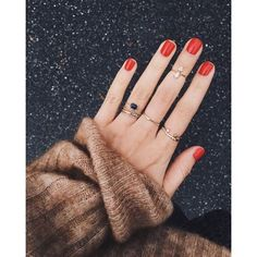 red nail and rings