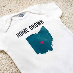 Create some gender-neutral baby onesies with three different heat transfer vinyl designs for your Silhouette: all FREE to download!