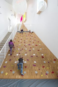 "Ama'r Children's Culture House, Denmark. Dorte Mandrup Architects  Building designed as a ""mountain"" with connecting spaces"