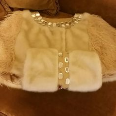 FABULOSITY FOR SALE COUTURE STYLE This absolutely gorgeous faux fur and yes you seen it a matching muff THIS is too fabulous for words! Purchased at a boutique and only 1 Xfor a couple hours literally. The fur in the front, on the shaw, is white the fur on the side is a light tan. On the the muff the inside is lined with the light tan and has a suede stripe down the middle with blinged out to match the color of the blinged-out shaw, both w/suede trim. The  muf comes with a dust bag as well…