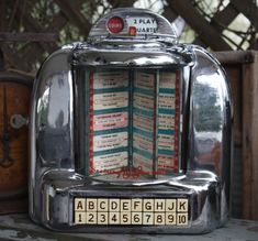 TABLE TOP JUKE BOX: This is a Seeburg Wall-O-Matic 100 Juke Box. This little table top version would sit at the table in a diner. It was connected to a larger main unit stored somewhere in the backroom of the diner. You would put in your coin and be able to select a couple songs that played right at your table.
