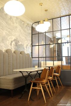 Fornasetti cloud wallpaper, banquette seating hotel paradis, paris