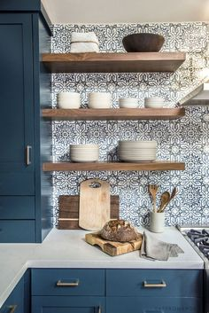 Detailed backsplash. Open shelves instead of cabinets. Plain (add sto me pretty glass) cubs bowls pates etc