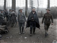 A wounded German prisoner being led by a Portuguese soldier and a soldier from the 51st Division, near Bethune, April 10, 1918. Three days after the Battle of La Lys.