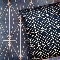 Navy and gold interior is so stylish. Use the Arna Geometric Wallpaper in Blue and Bronze for a modern finish.