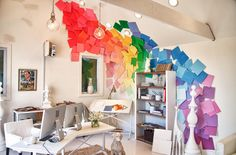 Michael Moloney created a wall of paint swatches (using pieces of card stock) that climb up the ceiling for a 3D art look.