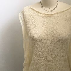 ANTHROPOLOGIE FAR AWAY FROM CLOSE TOP ANTHROPOLOGIE FAR AWAY FROM CLOSE TOP. BEAUTIFUL crocheted lace top in cream. Never worn. Needs camisole underneath. Anthropologie Tops