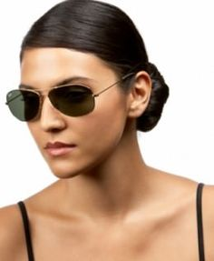 These black colored sunglasses look wonderful because of the thin frame and big glasses. The classic black tinted aviator glasses for women is simply a must have, for your sunglass collection as seen here worn by the model.