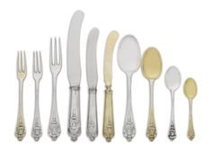 A Victorian Silver and Silver-Gilt Flatware Service, Charles Johnston Hill, London, 1881 the handle terminals cast with profiles of Queen Anne and Prince George of Denmark, the reverse cast with monogram, comprising: twenty-four dinner knives twenty-four three-prong dinner forks twenty-four cheese knives twenty-four lunch knives twenty-four dessert knives, gilt twenty-four dessert forks, gilt twenty-four teaspoons twenty-four teaspoons, gilt twenty-four dessert spoons etc 306 pieces
