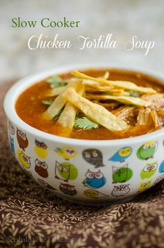 Chicken Tortilla Soup in the slow cooker by SeededAtTheTable.com this is a VERY spicy soup. I like to take out about half the spice and add more salt and fajita seasoning instead. Also I eat it with lactose free sour cream and goat cheese swirled in