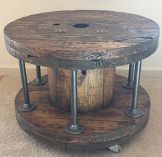 A gorgeous handmade piece inspired by factory cable spools and wire reels, this rustic table is the perfect addition to any industrial, rustic style decor.  This one-of-a-kind piece is made from an upcycled industrial cable spool. Its extremely stout and heavy duty. It features a rich dark Ash stained finish, with a hand-rubbed semi-gloss top coat of polyurethane for a beautiful, long-lasting appearance. But it still has original markings, splits, nail holes, and signs of use that only add…