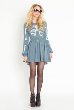 Blue Skeleton dress matched with nylons, cross necklace, Jeffery Campbell lace-up boots, and big sunglasses.