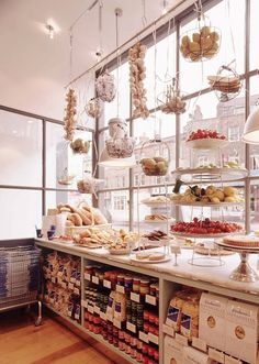 Great use of window - hanging products bakery design, cafe design, store design, Café Restaurant, Restaurant Design, Bakery Cafe, Bakery Store, Bar Design, Store Design, Deli Shop, Design Garage, Food Retail