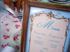 Up-cycling frames from your local Oxfam shop...? From http://emilysummers-designer.blogspot.co.uk/2012/07/vintage-tea-party-menu.html