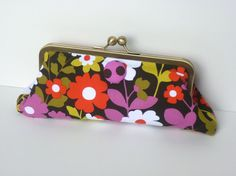 This is a little on the bold side, but I think this clutch is cute. :)