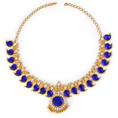 SKU: MNK5 Product Details: Gold(22K, 46 gms), American Diamonds and Glass (10.8 gms) Description: The Blue Mango Mala is colourful, vibrant and striking. Accentuated by american diamonds and paisley shaped blue glass extending from a 22K gold chain, this necklace can be the finishing touch to your bridal ensemble.