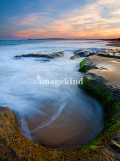 """Tidal Bowl"" by Mike Dawson, Yakima, Wa // A bowl like depression in a stone shelf catches the incoming tide as the sun sets over Encounter Bay, South Australia. // Imagekind.com -- Buy stunning, museum-quality fine art prints, framed prints, and canvas prints directly from independent working artists and photographers."