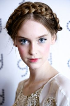 Inspired by Russian folklore, the looks entails soft, pretty braids wrapped onto the top of the head with loose pieces of hair falling in front of the face. Don this ethereal style when you're feeling girly... and in the mood for some modern day Babushka-ness!