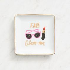Adorable, white grounded, square, ceramic trinket dish with the quote You're Fab, Glam-ma! Ideal for the stylish grandmas or moms in your life. Paper Source design features metallic accents and cute