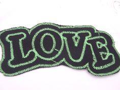 Iron on applique fabric green black love. $1.00, via Etsy.