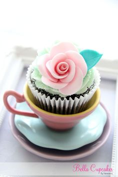 Such a pretty cupcake in a teacup.