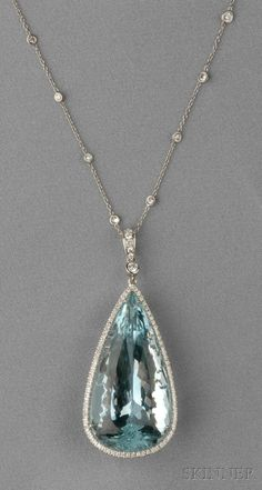 18kt White Gold, Aquamarine, and Diamond Pendant and Chain, the large pear-shape aquamarine measuring approx. 40.00 x 20.00 x 13.60 mm, and weighing approx. 50.00 cts., framed by diamond melee, and suspended from a trace-link chain with bezel-set diamonds, lg. 2 1/4, 17 1/2 in