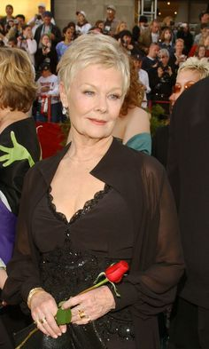 Holding a red rose, Dame Judi Dench arrives for the 74th Annual Academy Awards held at the Kodak Theatre in Hollywood, Ca. Description from marriage.about.com. I searched for this on bing.com/images