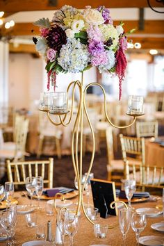 Lots of gold with touches of light blue and deep purple, These flowers were AMAZING @flowershopenc photo by @halffulljoey rentals from @ConceptsEventSD