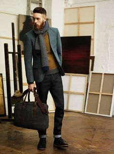 Shop this look for $391:  http://lookastic.com/men/looks/blazer-and-jeans-and-scarf-and-crew-neck-sweater-and-desert-boots-and-briefcase/1907  — Grey Blazer  — Navy Jeans  — White and Navy Polka Dot Scarf  — Mustard Crew-neck Sweater  — Black Suede Desert Boots  — Charcoal Leather Briefcase