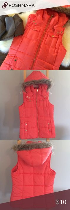 Faux fur trimmed puffer vest Perfect for those cool fall days paired with your favorite jeans and boots! Fur is only around the hood and is a mix of tan and gray. Body Central Jackets & Coats Vests