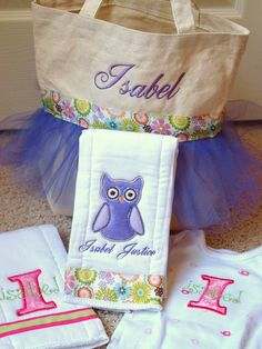 Personalized baby gift set. Includes two burp cloths, a onsie, and a matching tutu bag.. $47.50, via Etsy.