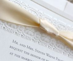 lace and ribbon wedding invitation