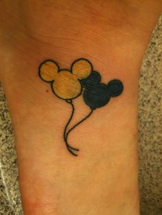 Super CUTE! Mickey and Minnie tattoos...maybe get a bow on one of them?