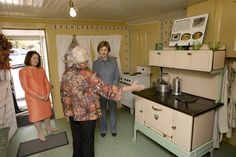 First Lady Laura Bush in the kitchen of Laura Ingalls Wilder's Mansfield, MO home.