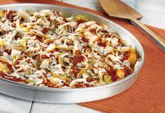 "Pasta Pizza Pie - Tri-colored corkscrew pasta creates a tasty bottom ""crust"" to top with tomato sauce, a savory mushroom-onion sauté and mozzarella cheese."