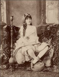 """Inside the hareem - a portrait from the 1850s by H. Arnoux. Lets see what's wrong with this picture. (1) what harem girl sits like that? (2) what's with the hair? (3) $2.00 says she's never smoked a hookah before. (4) The expression says """"I'm so bored I have actually turned to stone."""""""
