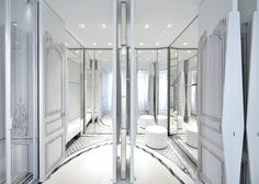 The best fashion house installations at Milan Design Week: Maison Margiela The new store will house its new creative director, John Galliano's, first haute couture collection. Glass cabinets and mirrored walls sit alongside trompe-l'oeil that gives the effect of traditional wood panelling and mouldings on the walls.