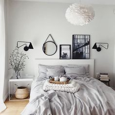 Very pale green wall, white furniture, grey comforter