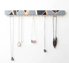 This jewelry holder features a dynamic hand-painted color scheme of black, white and shades of gray. Geometric abstract design reveals hints of