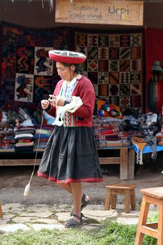 Peru. I have a drop spindle too but never got the hang of it.   Still. Look how awesome she looks! I love culture!