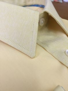 Great British Bespoke Cream Yellow Shirt with contrasting Linen Collar & Plaquet Front Strap    The shirt body is an plain yellow solid poplin & the contrasting fabric is matching and monochromatic in colour except the plaquet button strap, collar and cuffs are in a100% Irish Linen fabric, a Linen/Bamboo blend and 3ply loose weave fabric.  This fabrics is light weight and helps to wick moisture away from the neck and wrist, making it ideal for the summer months or them well earned overseas…