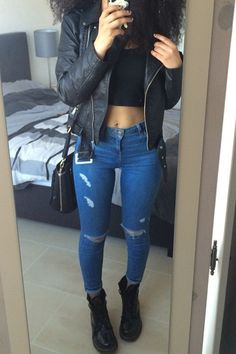 black moto jacket + black crop top + skinny jeans + black cross body purse + black Doc Marten's