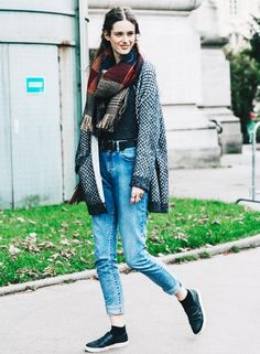 Wear an oversized cardigan with cropped boyfriend jeans, a plaid scarf, and slip-on sneakers